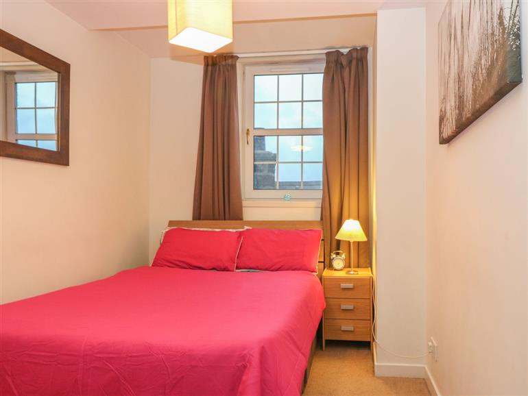 This is a bedroom at Harbour View Apartment in Aberdeen