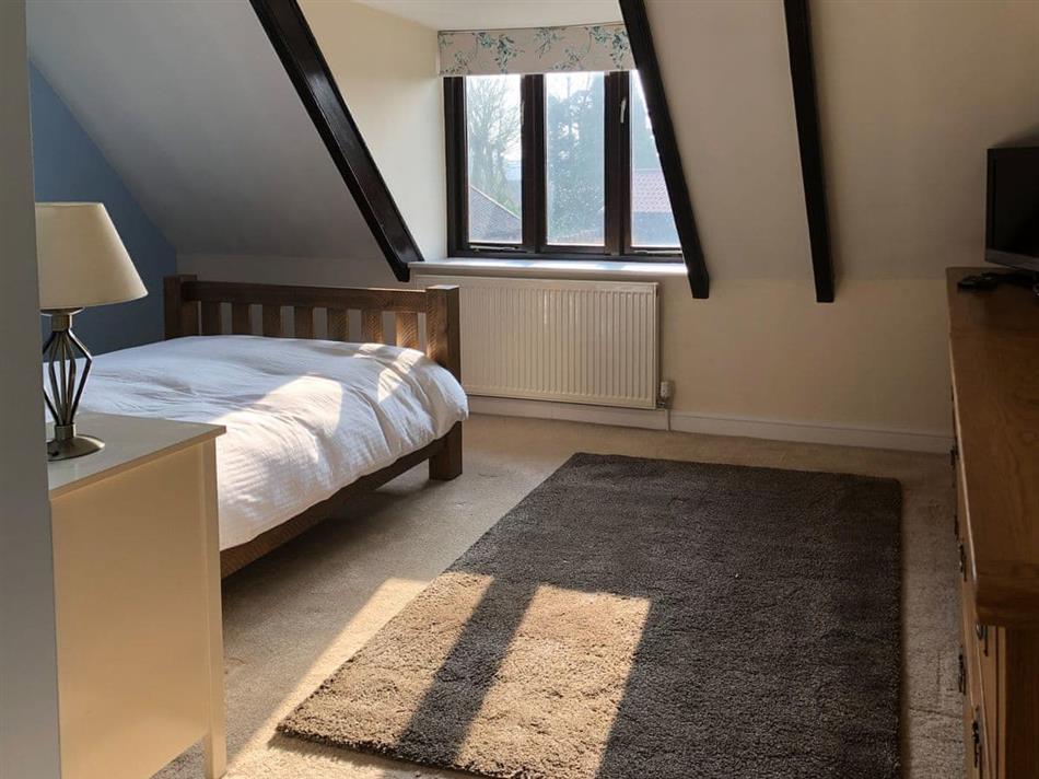 Bedroom in Lobelia Cottage, Stoke Holy Cross, near Norwich