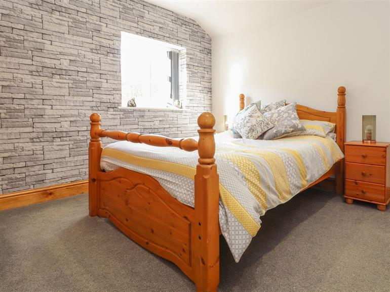 This is a bedroom at Orchard Leigh in Bridge near Portreath