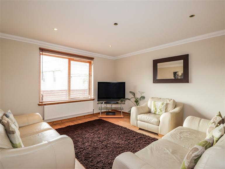 The living room at 2 Braeview in Wester Balblair near Beauly