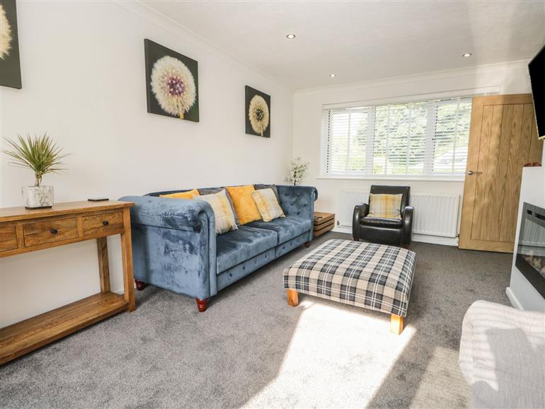 The living room at 26 Hycemoor Way near Millom