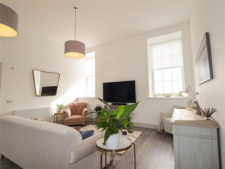 The living room at 35 Great Glen Place in Inverness