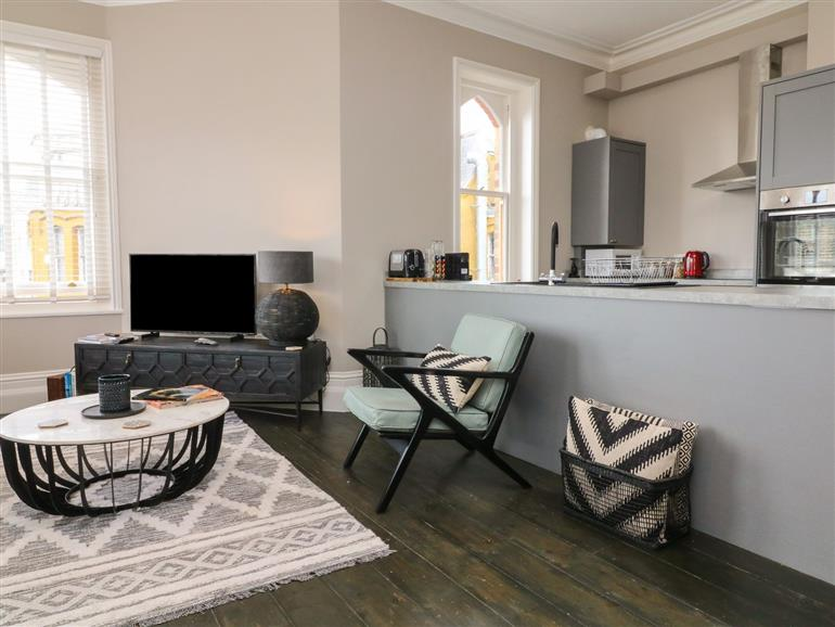 The living room at 7 Belgrave Apartments in Ilfracombe