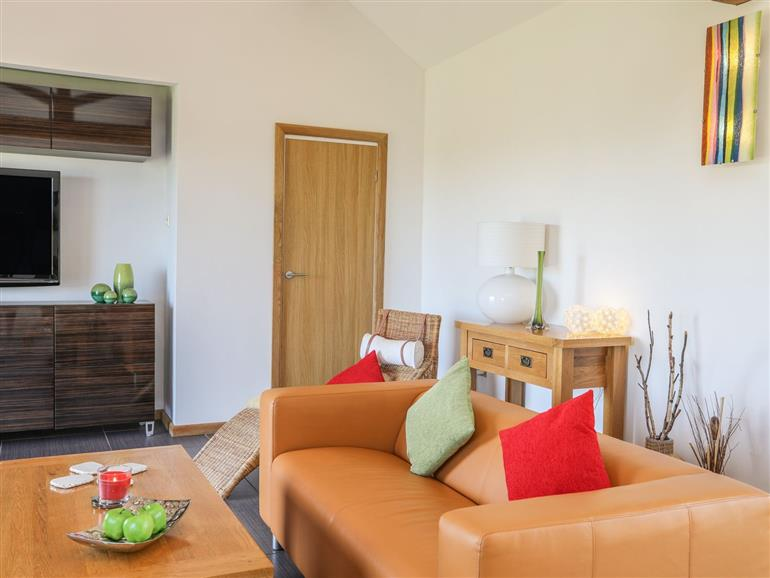 The living room at Barn Owl near Benllech