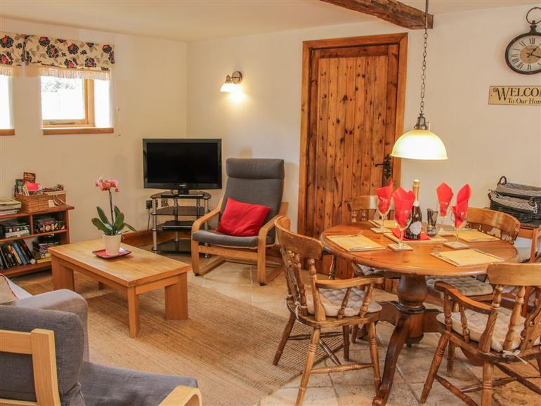 This is the living room at Beekeeper's Cottage in Broxwood near Pembridge