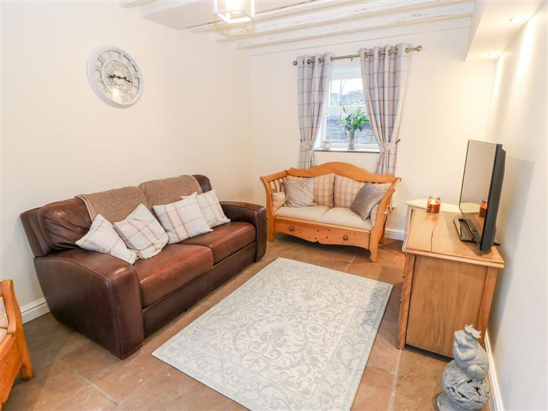 The living room at Clock Cottage in Lydgate near Saddleworth