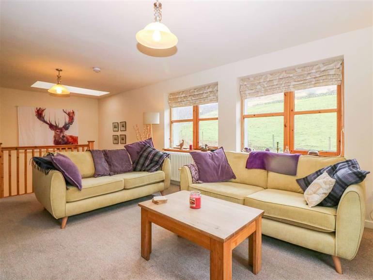 The living room at Drimnatorran Farm Lodge in Strontian