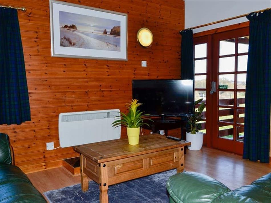 Living room in Bracken, Forfar