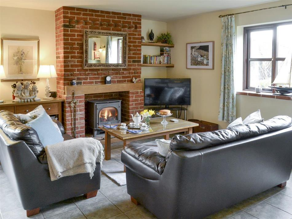 Living room in Riverside Cottage, Old Costessey, Norfolk