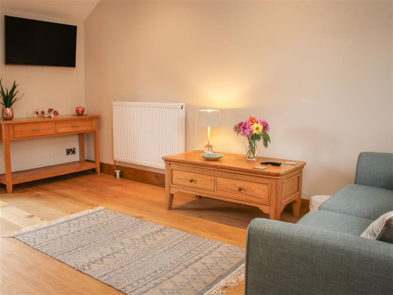 This is the living room at Meadow Barn in Aston On Clun