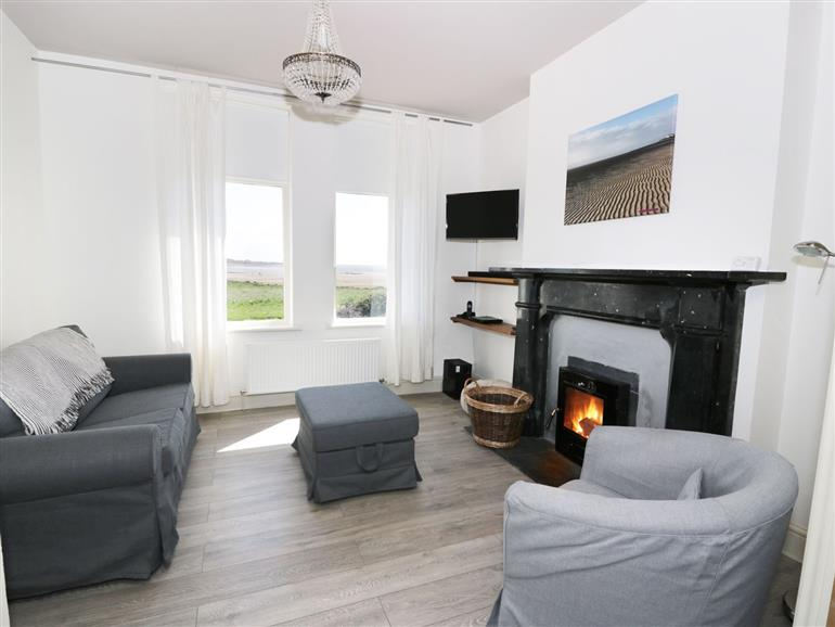 This is the living room at Pow-Wow Shore Cottage near Annan