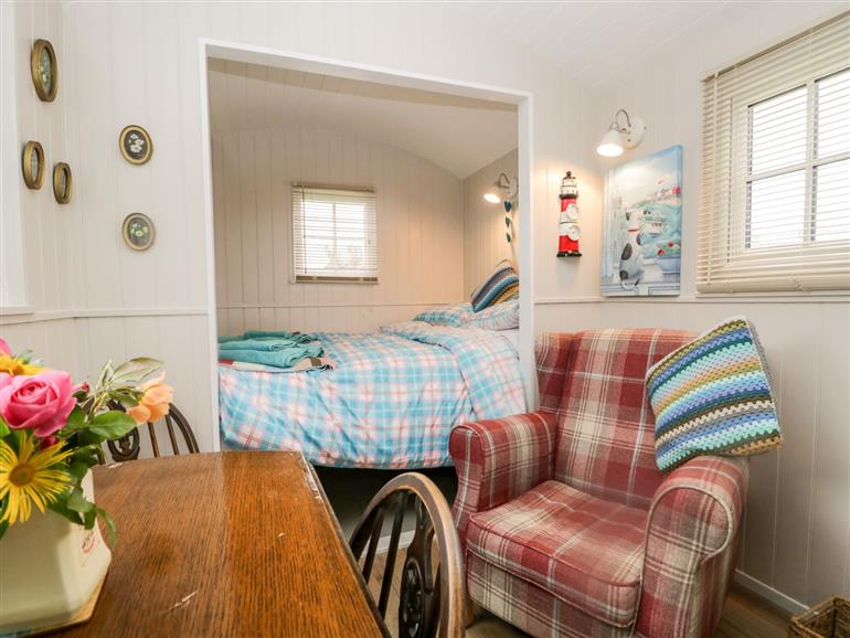 This is the living room at Seashore Shepherds Hut @ Moat Farm in Aldingham near Ulverston