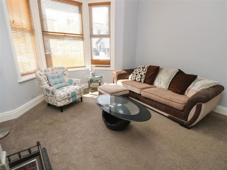 The living room at White Sand in Sandown